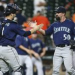Sep 26, 2016; Houston, TX, USA; Seattle Mariners catcher Mike Zunino (3) and relief pitcher Nick Vincent (50) celebrate after defeating the Houston Astros 4-3 in eleven innings at Minute Maid Park. Mandatory Credit: Troy Taormina-USA TODAY Sports