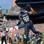 Seattle Seahawks' #88 Jimmy Graham celebrates a TD against the 49ers. (AP Photo/John Froschauer)