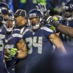 The Seattle Seahawks running back Thomas Rawls celebrates with teammates after a TD score. (Bettina Hansen / The Seattle Times)