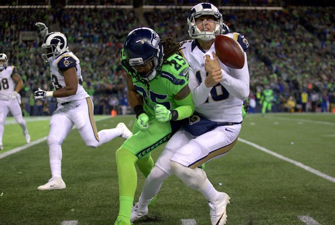 Seahawks Richard Sherman hits LA Rams Jered Goff in the Thursday Night Football game played in CenturyLink Field (Dean Rutz / The Seattle Times)