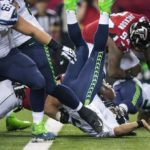 Russell Wilson gets sacked for a safety against Atlanta (Dean Rutz / The Seattle Times)