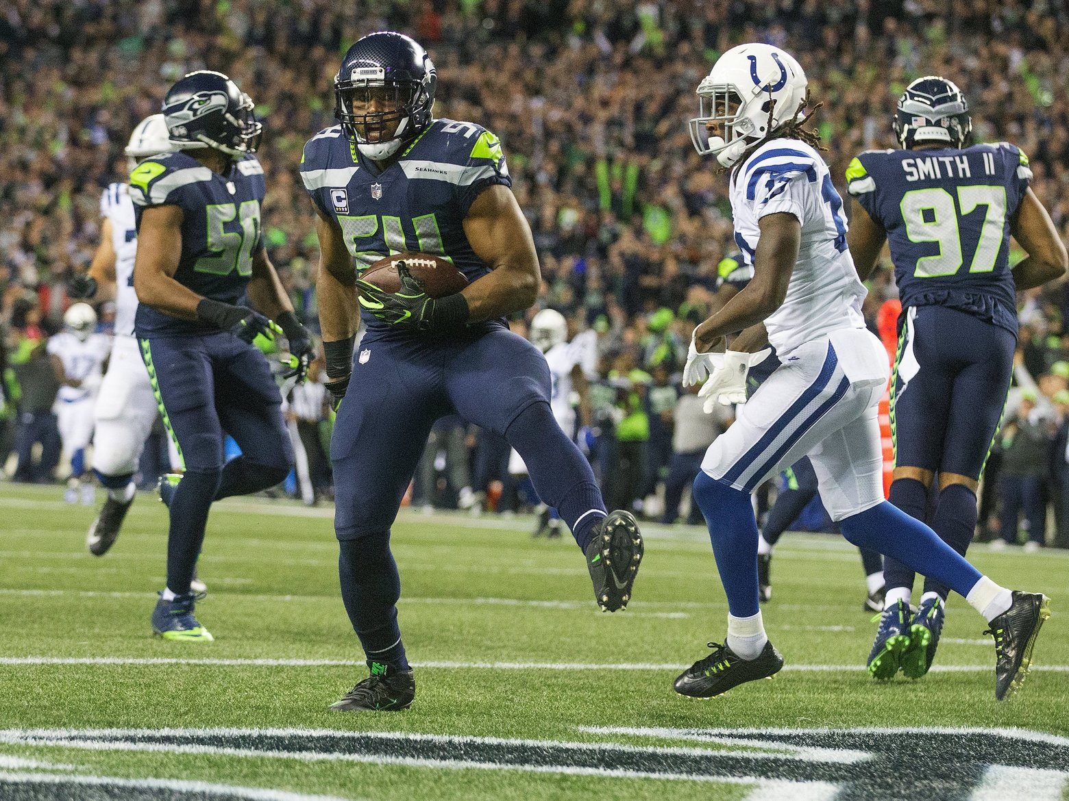 Seattle Seahawks' linebacker Bobby Wagner scores a fumble recovery TD against the Colts on Sunday Night Football (Mike Siegel / The Seattle Times)