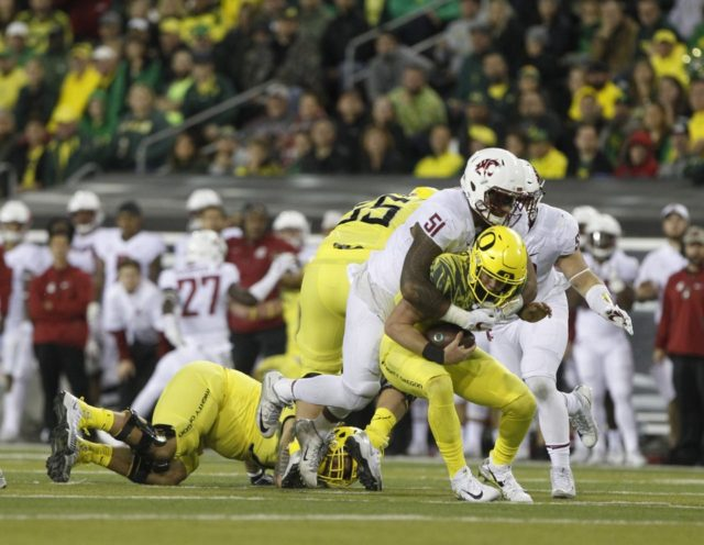 Undefeated #11 Cougars put Ducks to rest, 33-10