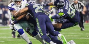 K.J. Wright and Earl Thomas put the hurt on Cowboys QB Dak Prescott (Dean Rutz / The Seattle Times)