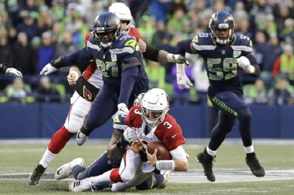 Seahawks win a sloppy game 27-24 against lowly Cardinals